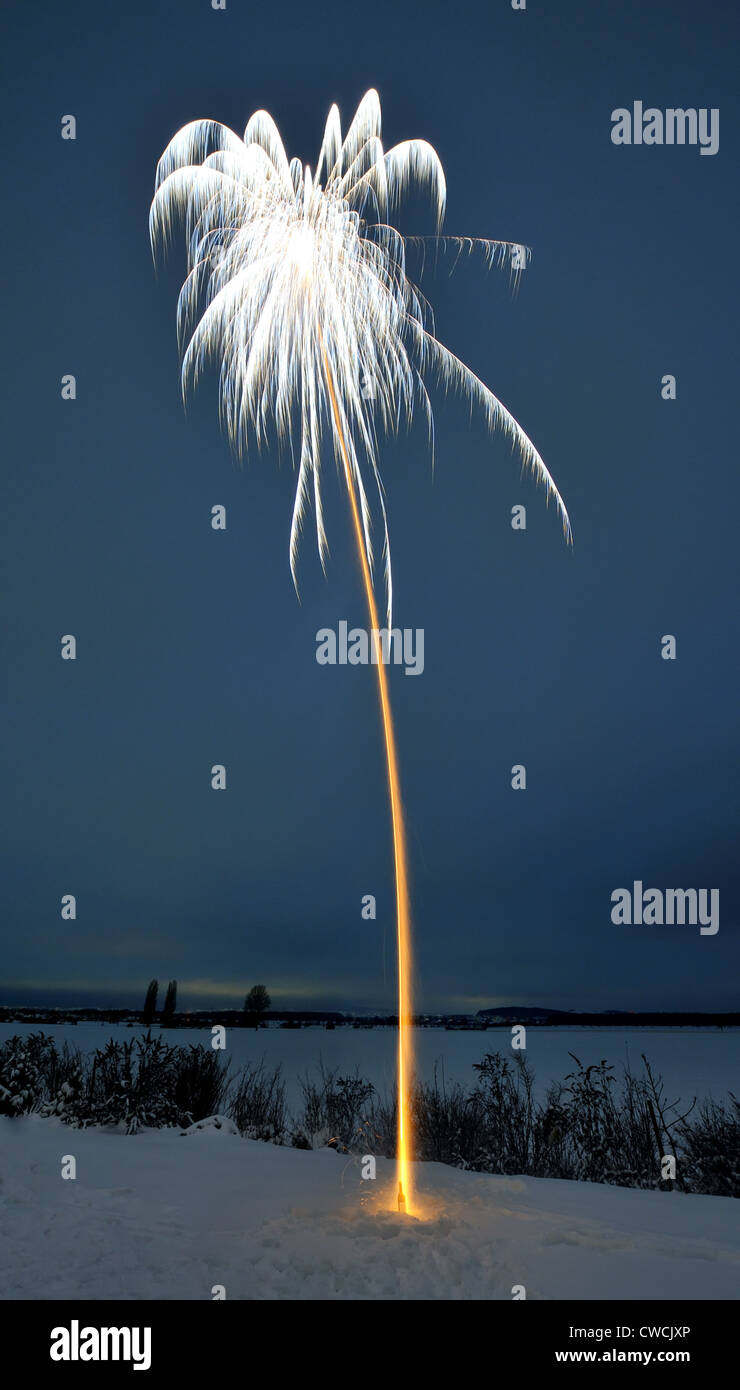 A long-term exposition of a firework. - Stock Image