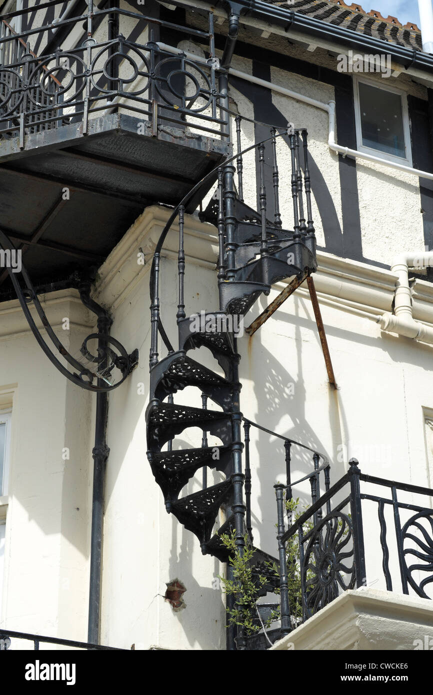 Wrought Iron Spiral Staircase Fire Escape On The Side Of A Building   Stock  Image