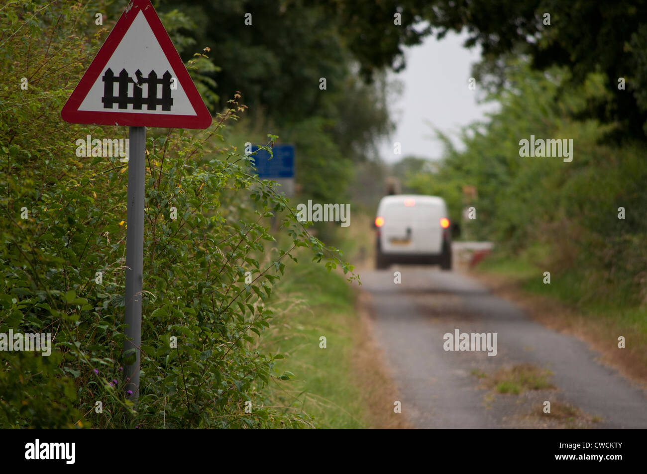 unmanned level crossing sign on country lane Stock Photo