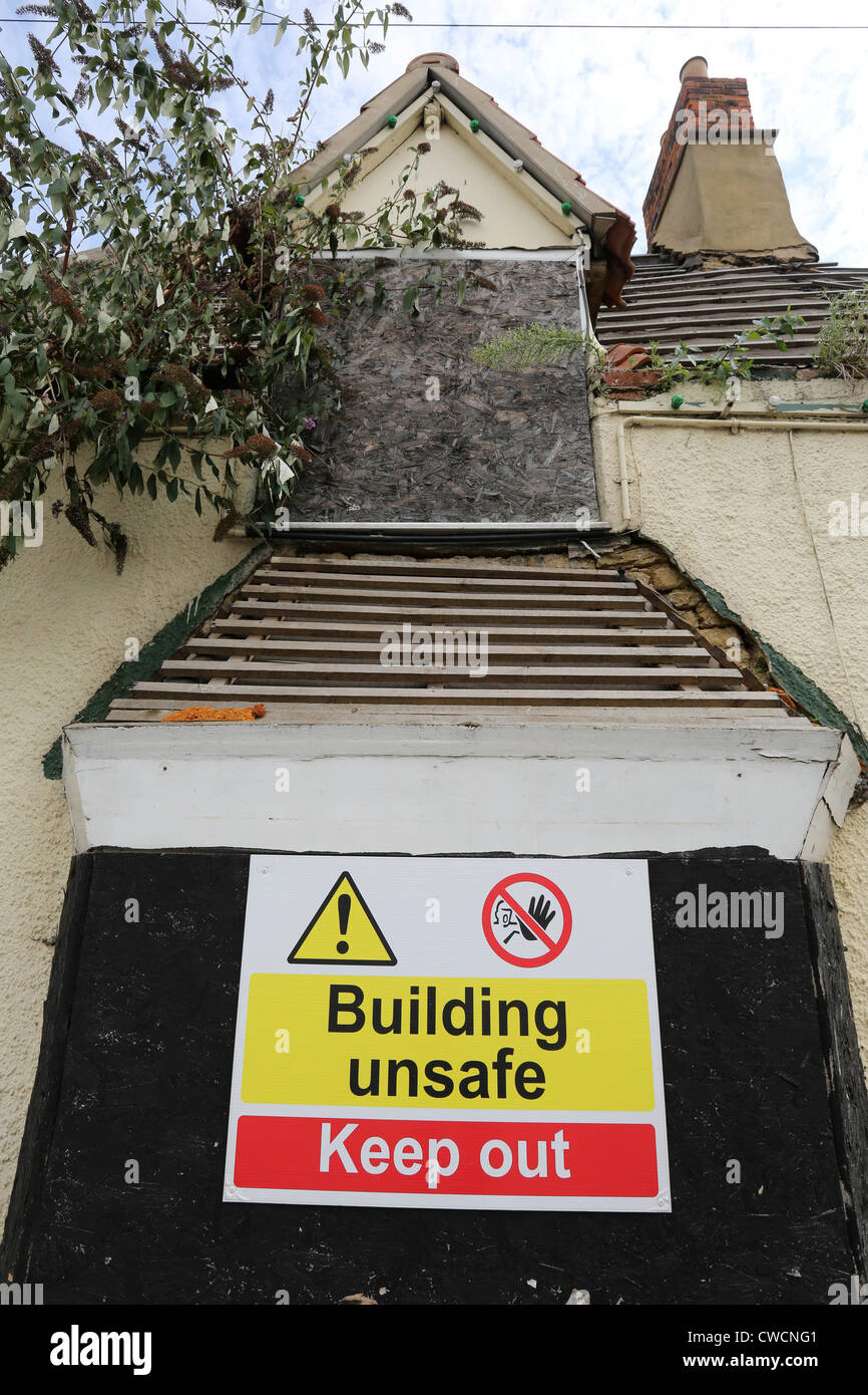 Unsafe building warning sign - Stock Image