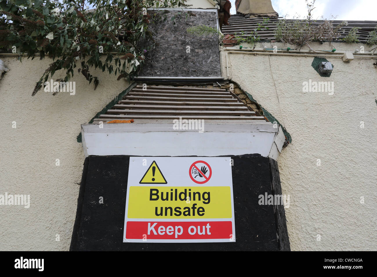 Unsafe building warning sign Stock Photo
