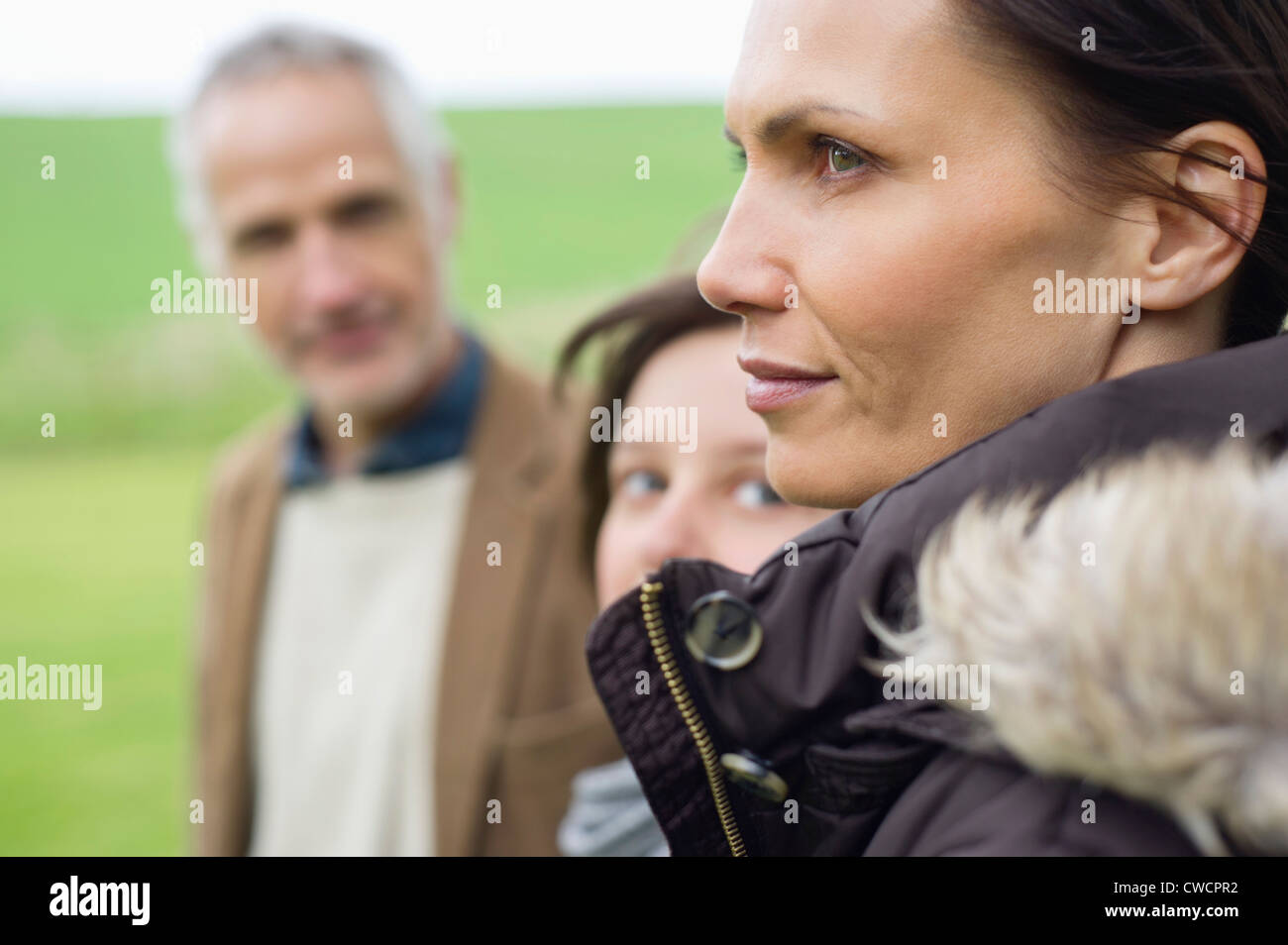 Close-up of a woman with her family - Stock Image