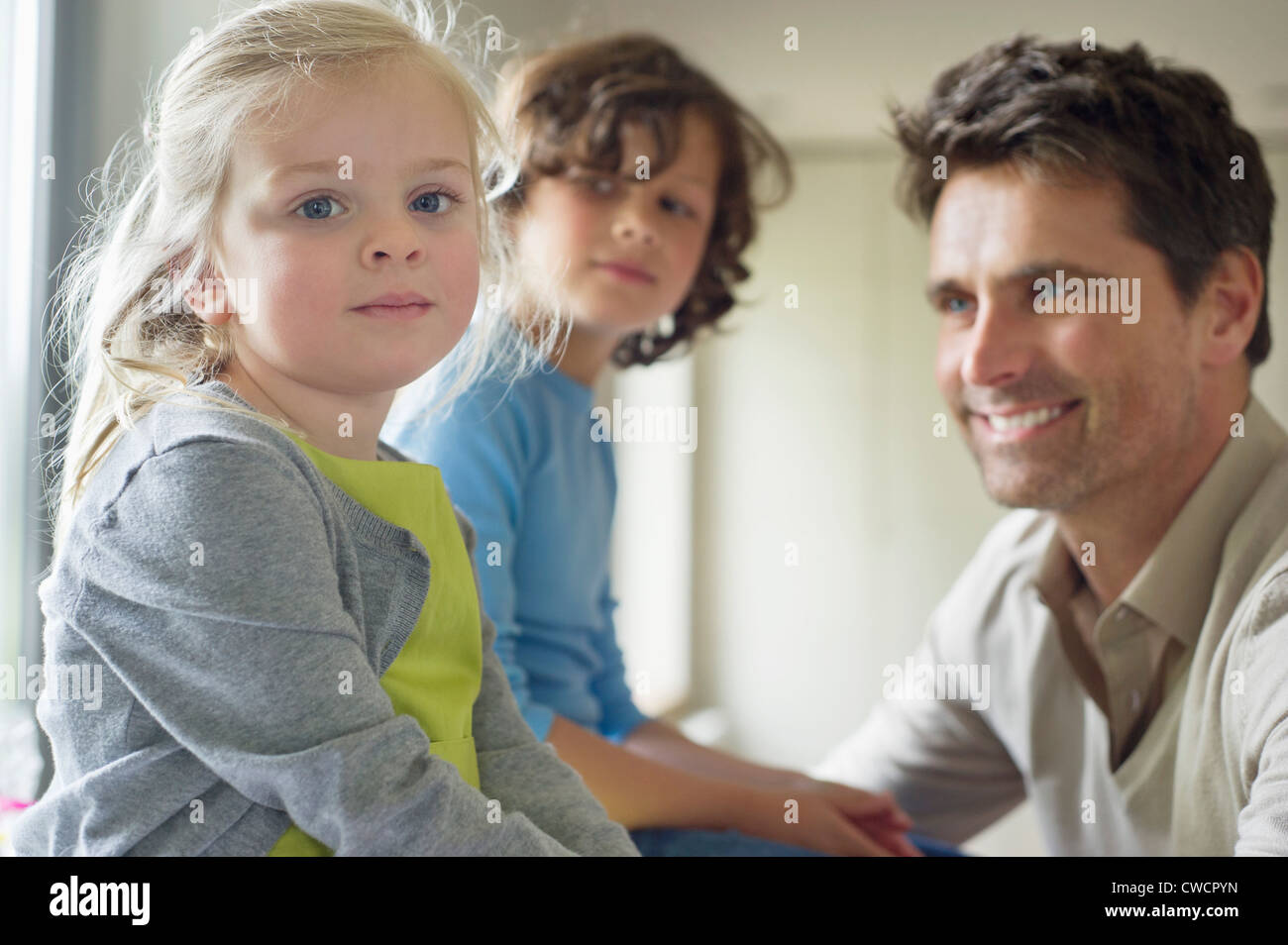 Man with their children at home - Stock Image