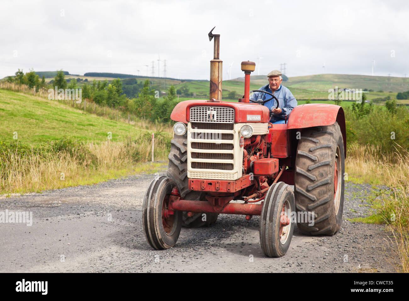 Old International Harvester : Enthusiast driving a red vintage international harvester