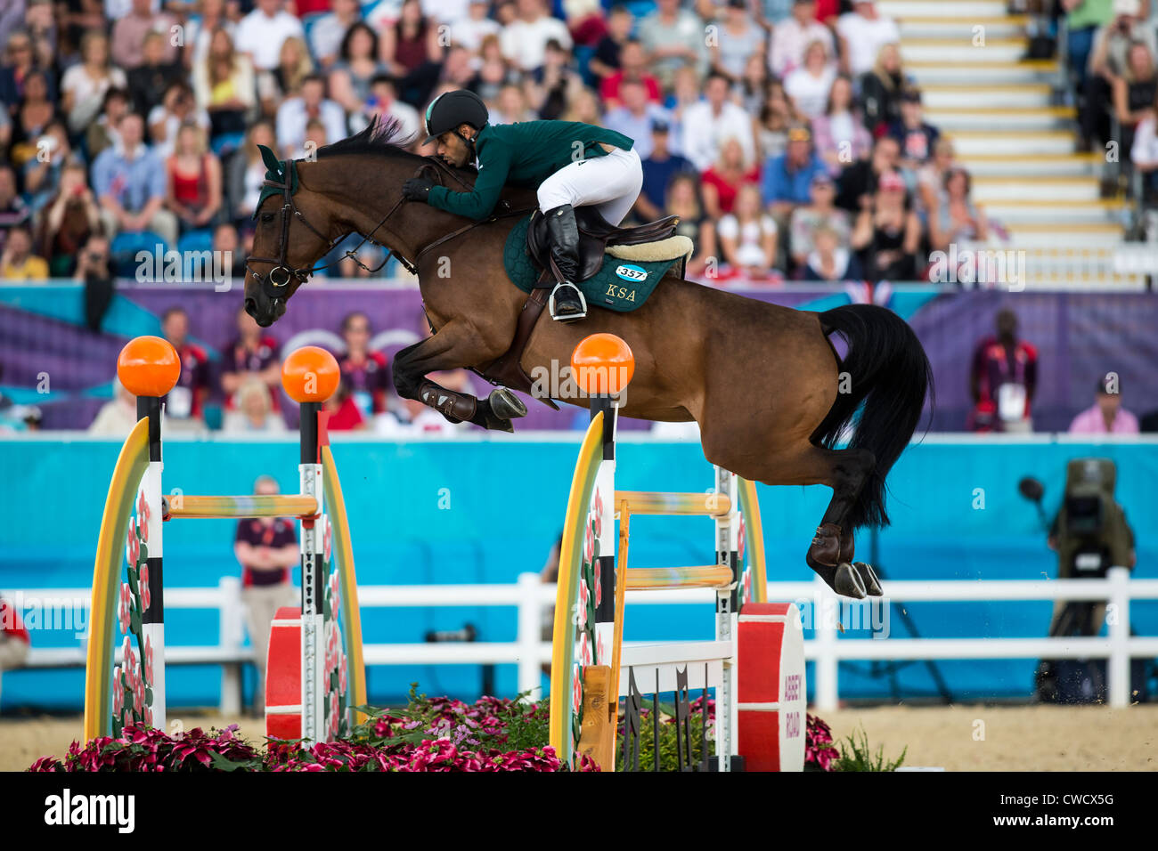Kamal Bahamdan (KSA) riding NOBLESSE DES TESS in the Individual Jumping Equestrian event at the Olympic Summer Games - Stock Image