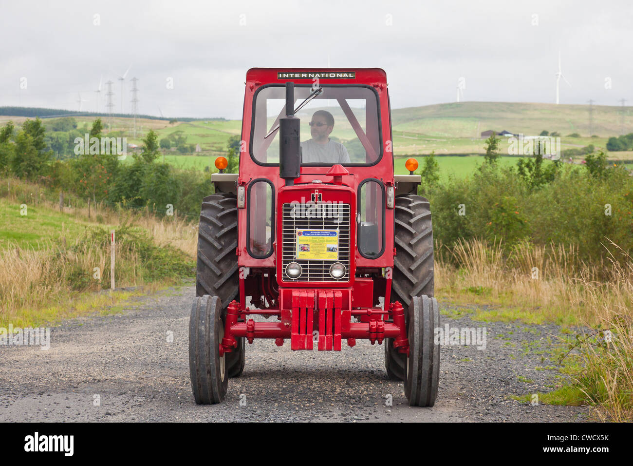 Enthusiast driving a redvintage International Harvester 634 tractor during an Ayrshire Vintage Tractor and Machine - Stock Image