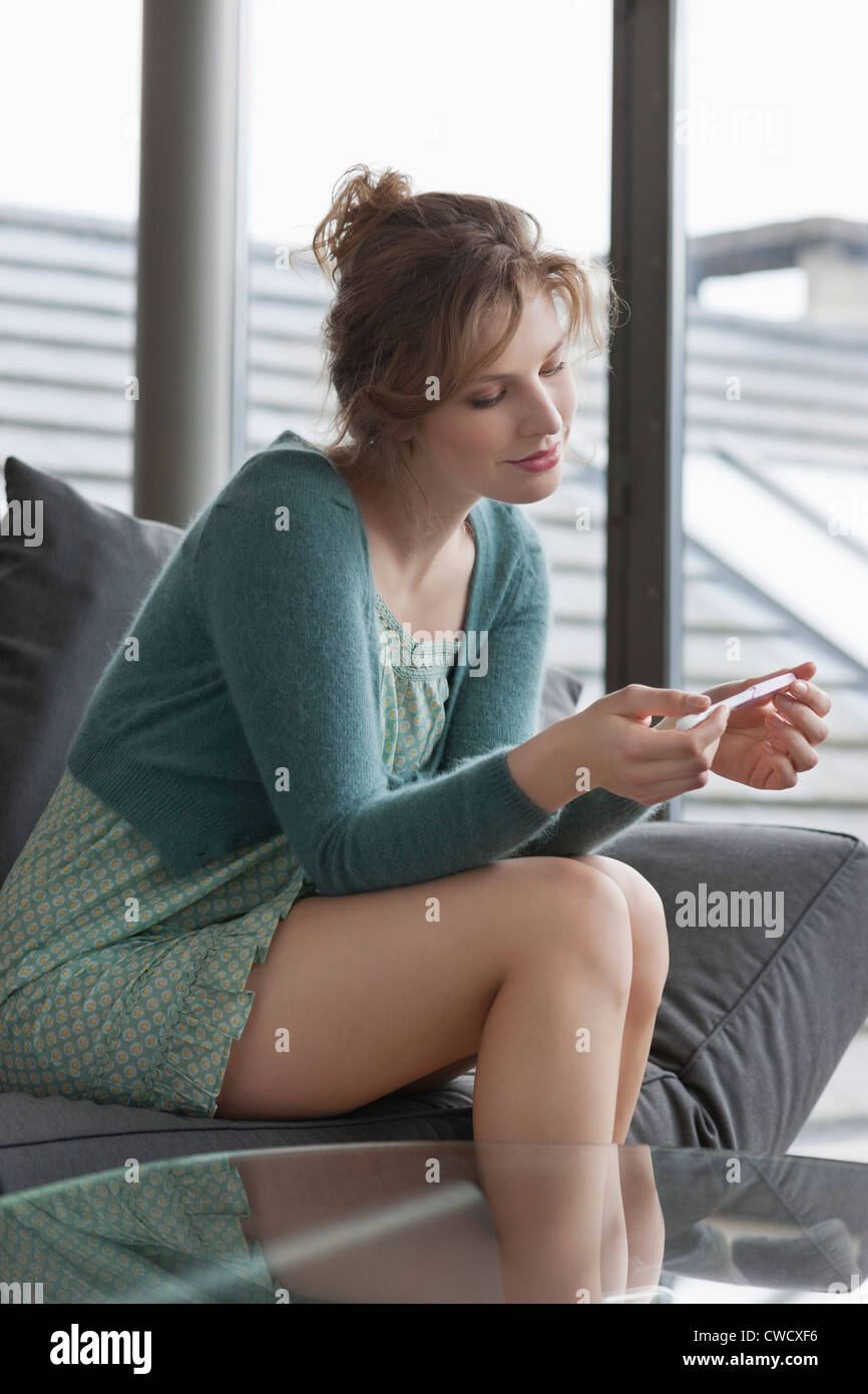 Woman checking her pregnancy - Stock Image