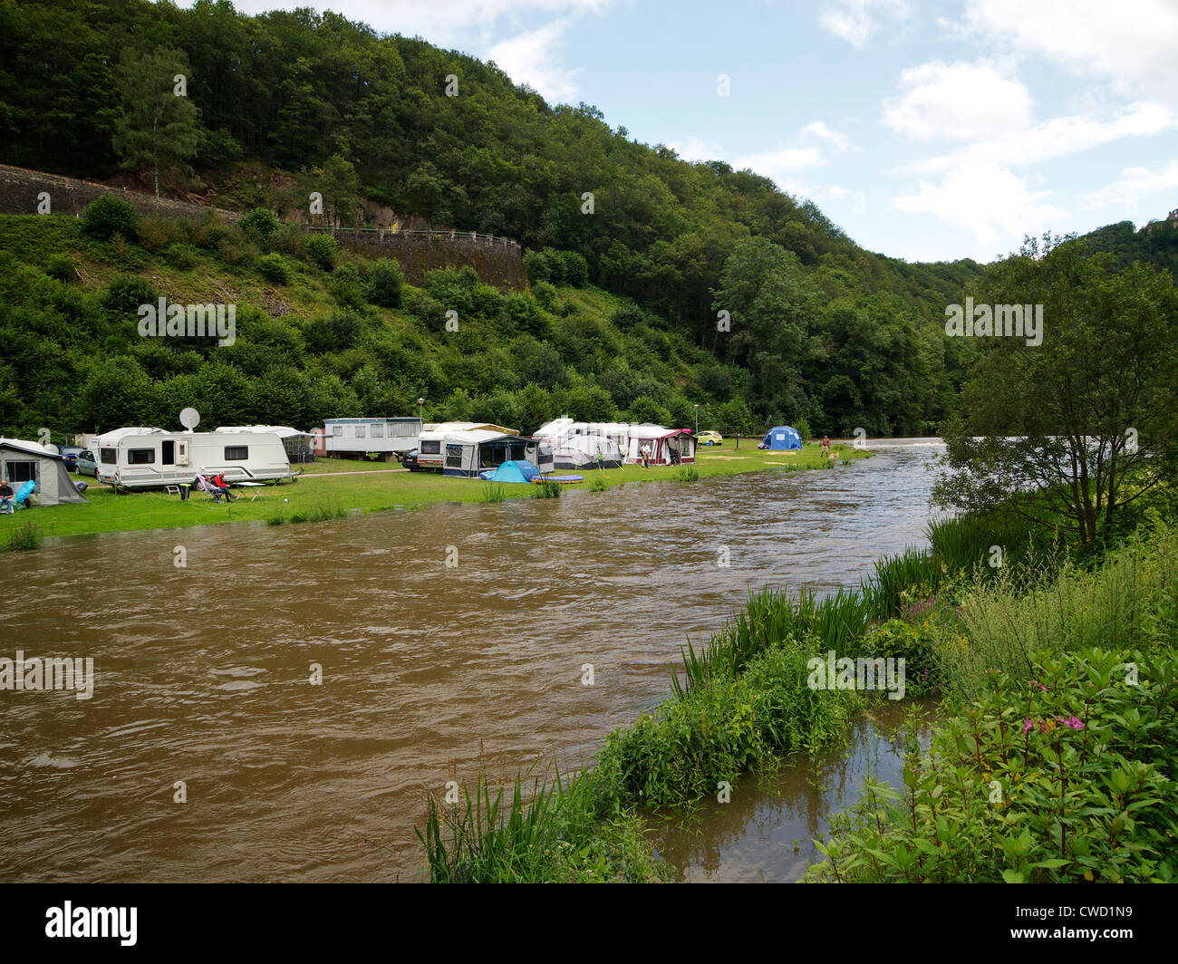 Very wet camping along the Sure river in Bourscheid, Luxemburg - Stock Image