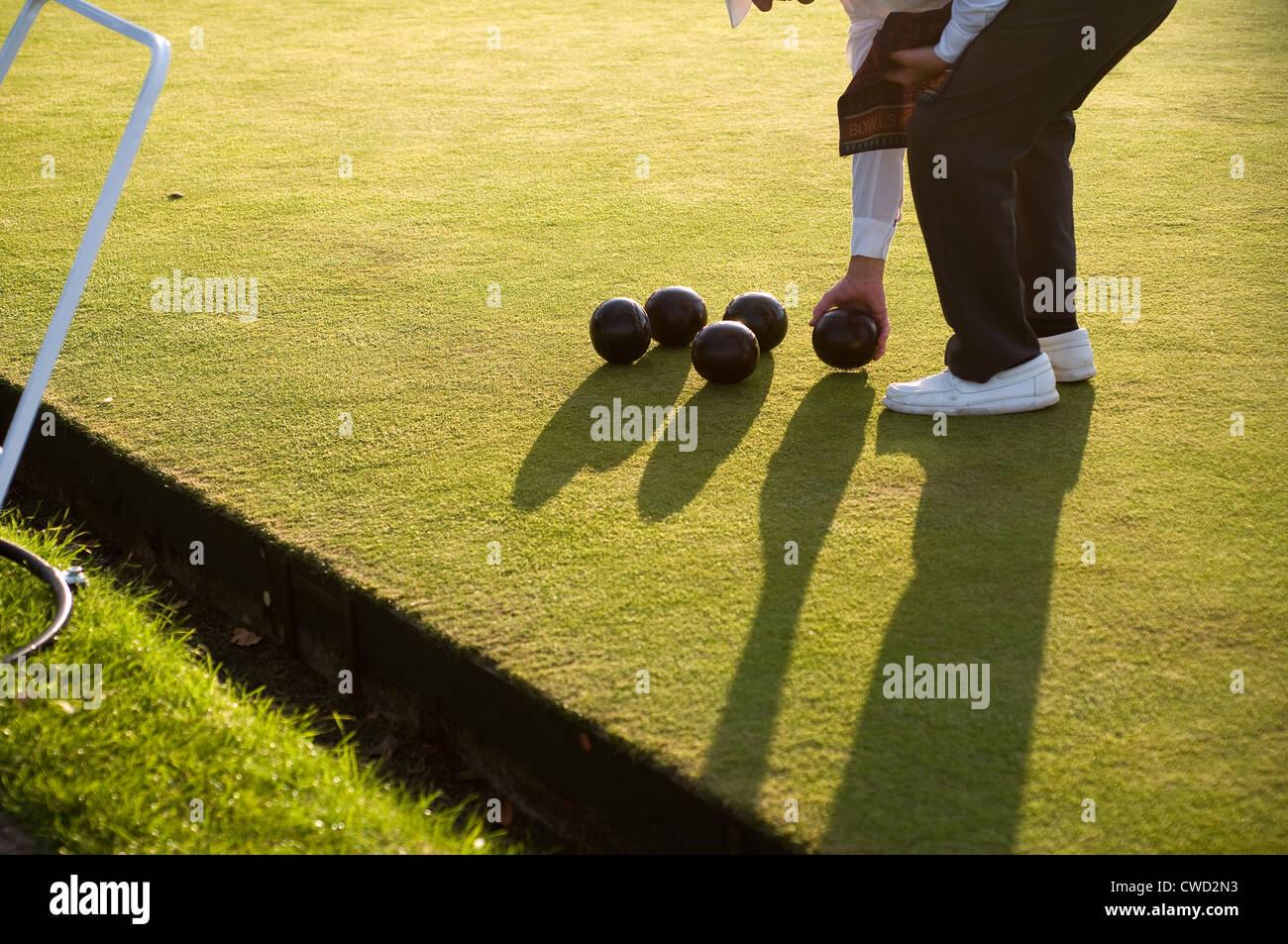 Bowls, lawn bowls, flat-green bowls and crown-green bowls, a sport ,biased balls, park,  accuracy, bowling, bowls,bowler, - Stock Image