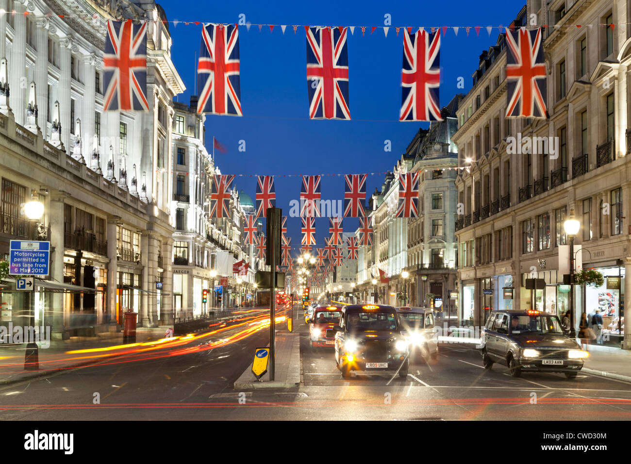 Regent Street with taxis and Union flags - Stock Image