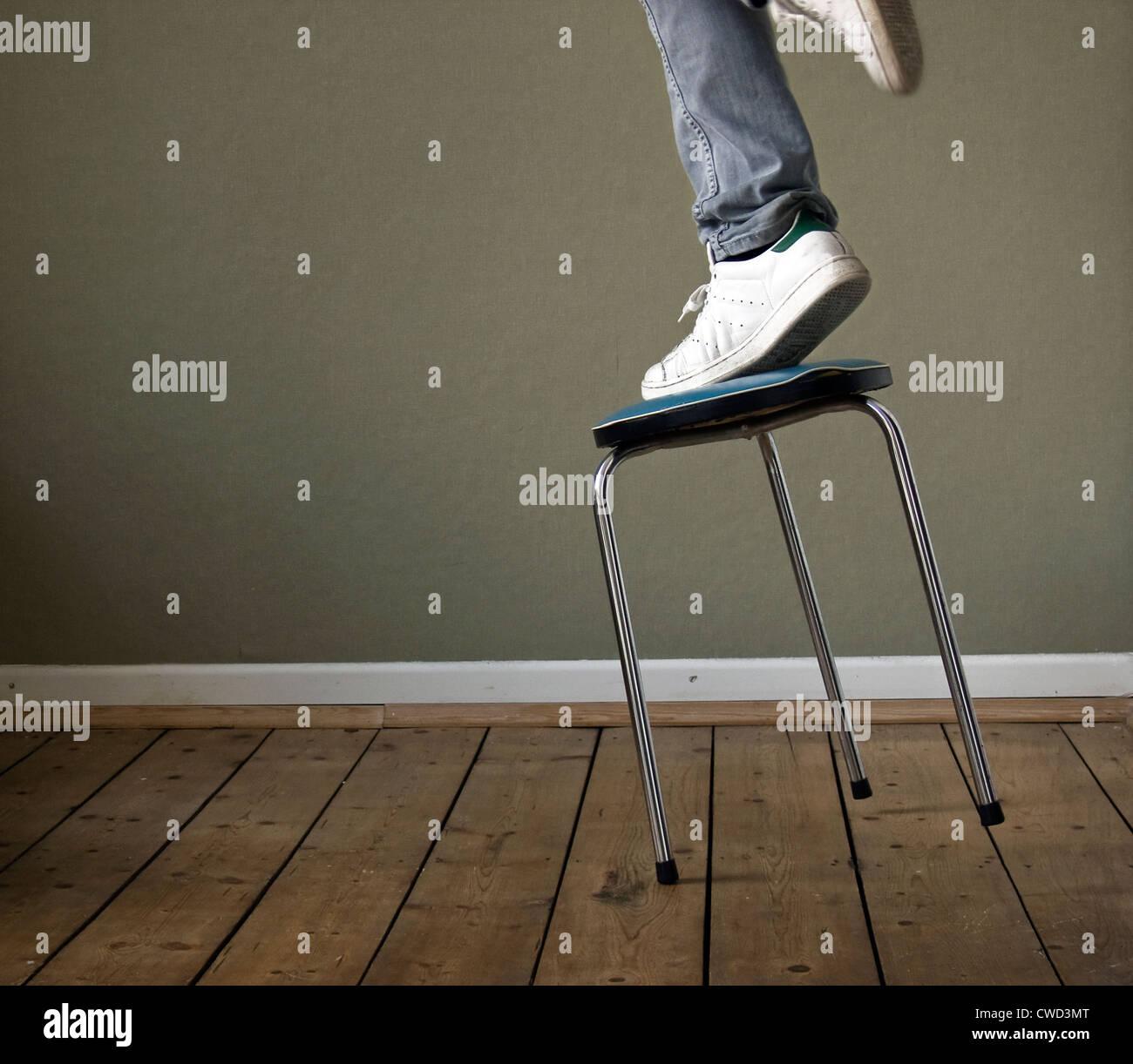 domestic life,accident,balance,fall - Stock Image