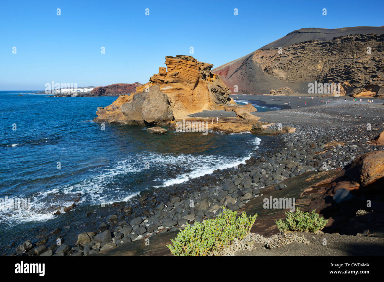 Rocky beach and lava cliffs at El Golfo - Stock Image