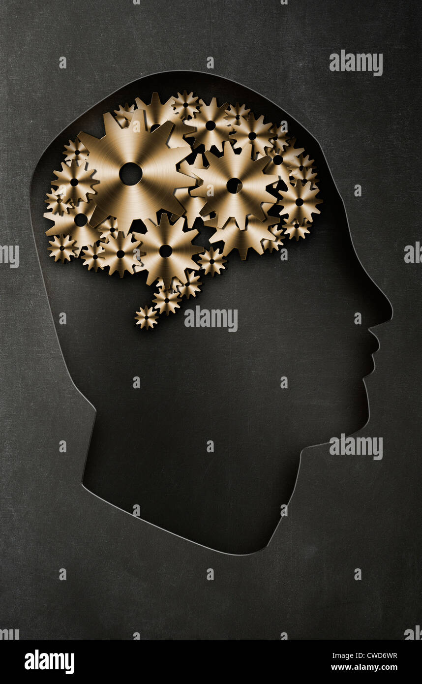 Profile of a man's head with a representation of the brain as cogs and gears. Concept image - Stock Image