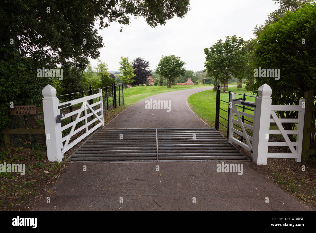 Cattle Grid Across Entrance To Country House With White