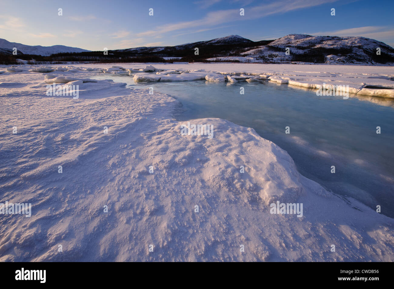 Winter landscape in Northern Norway, ice and snow on a frozen fjord - Stock Image