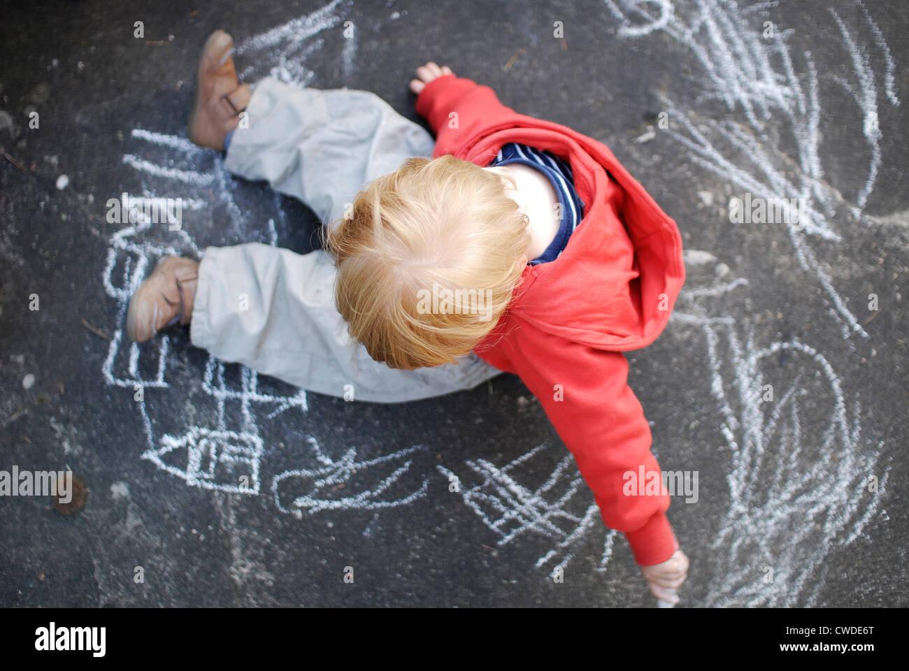 toddler,painting,chalk - Stock Image