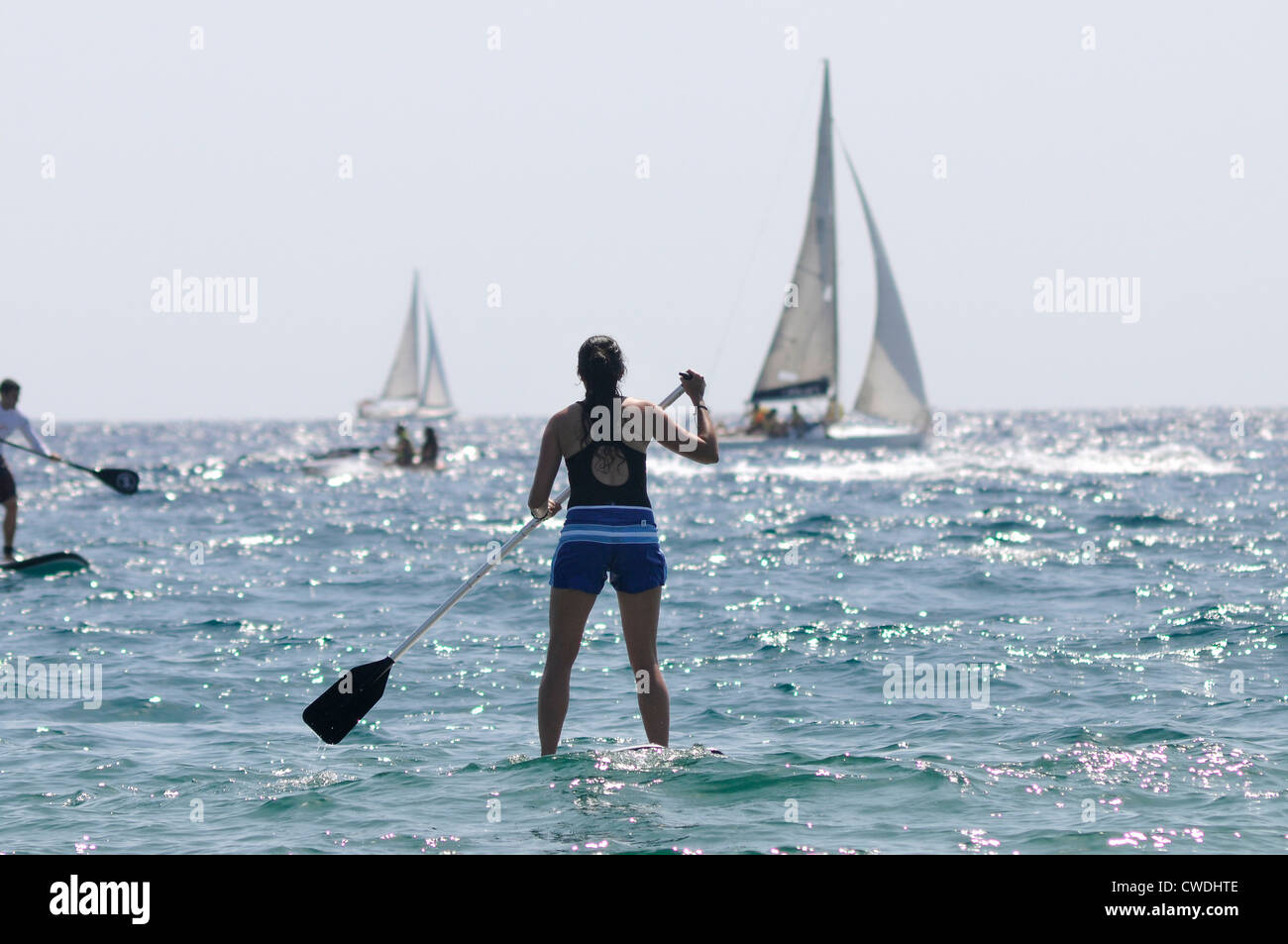 woman in the sea doing paddelsurf - Stock Image