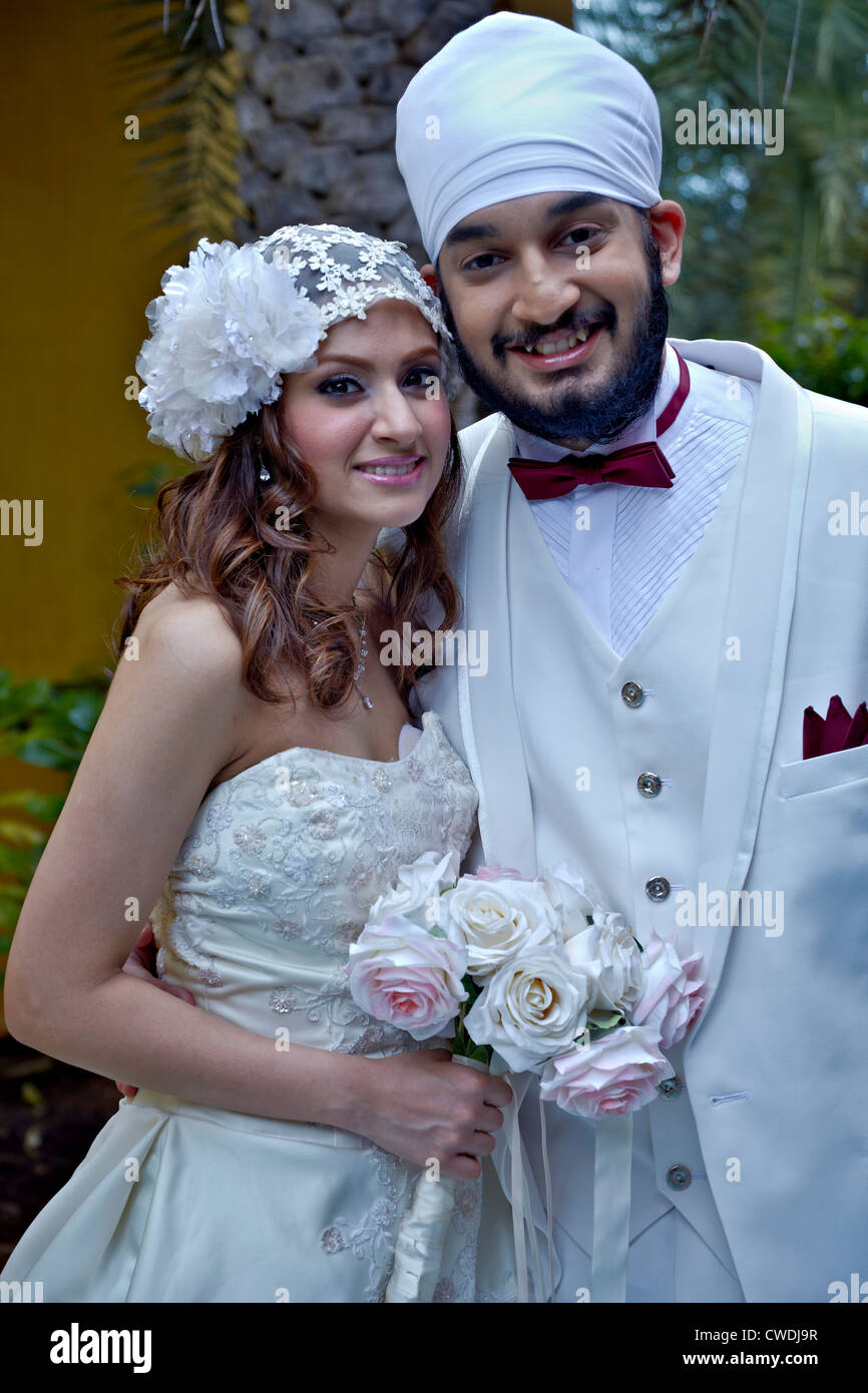 Asian Indian Married Couple Posing For Camera Southeast Asia Stock
