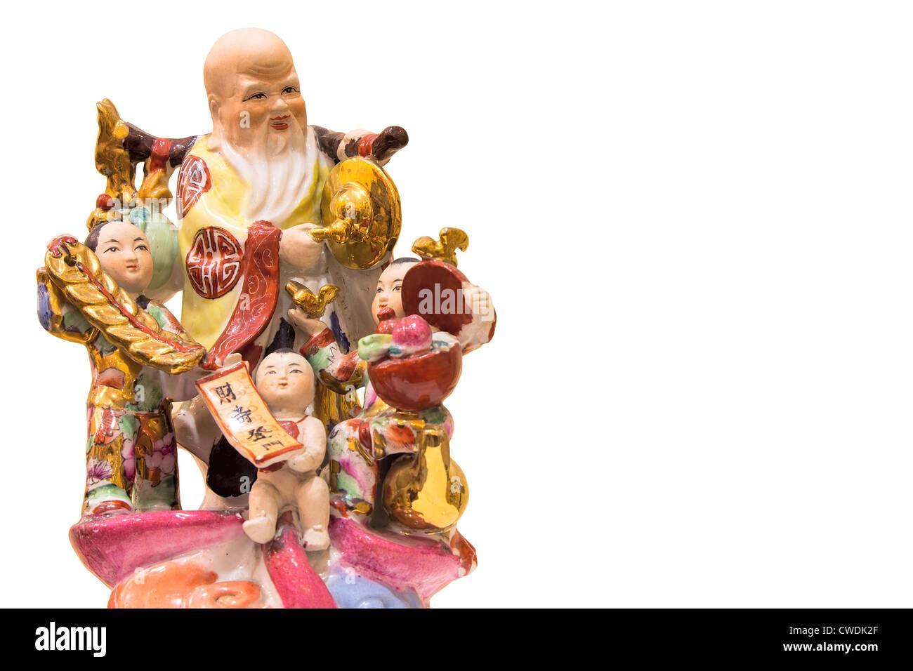 Longevity God Antique Porcelain Figurine with Three Prosperity Children Isolated on White Background - Stock Image