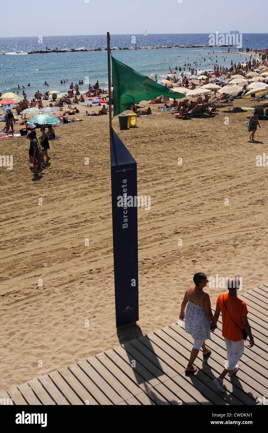 green flag indication beach services,  security flag on the seaside , BARCELONETA BEACH, Barcelona. Spain. - Stock Image