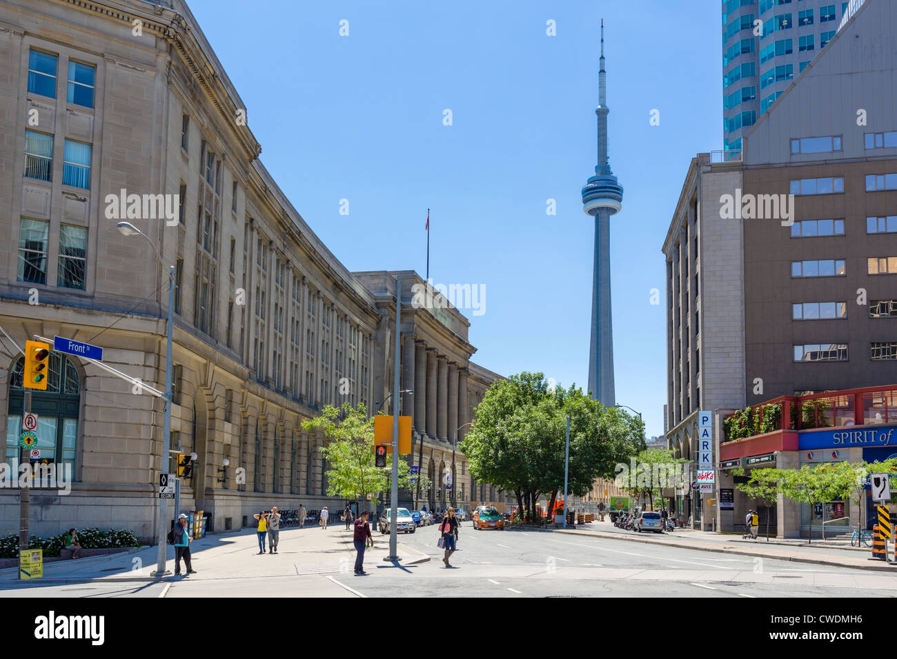 Toronto, Canada. View down Front Street towards the CN Tower with the Dominion Public Building to the left, Toronto, - Stock Image