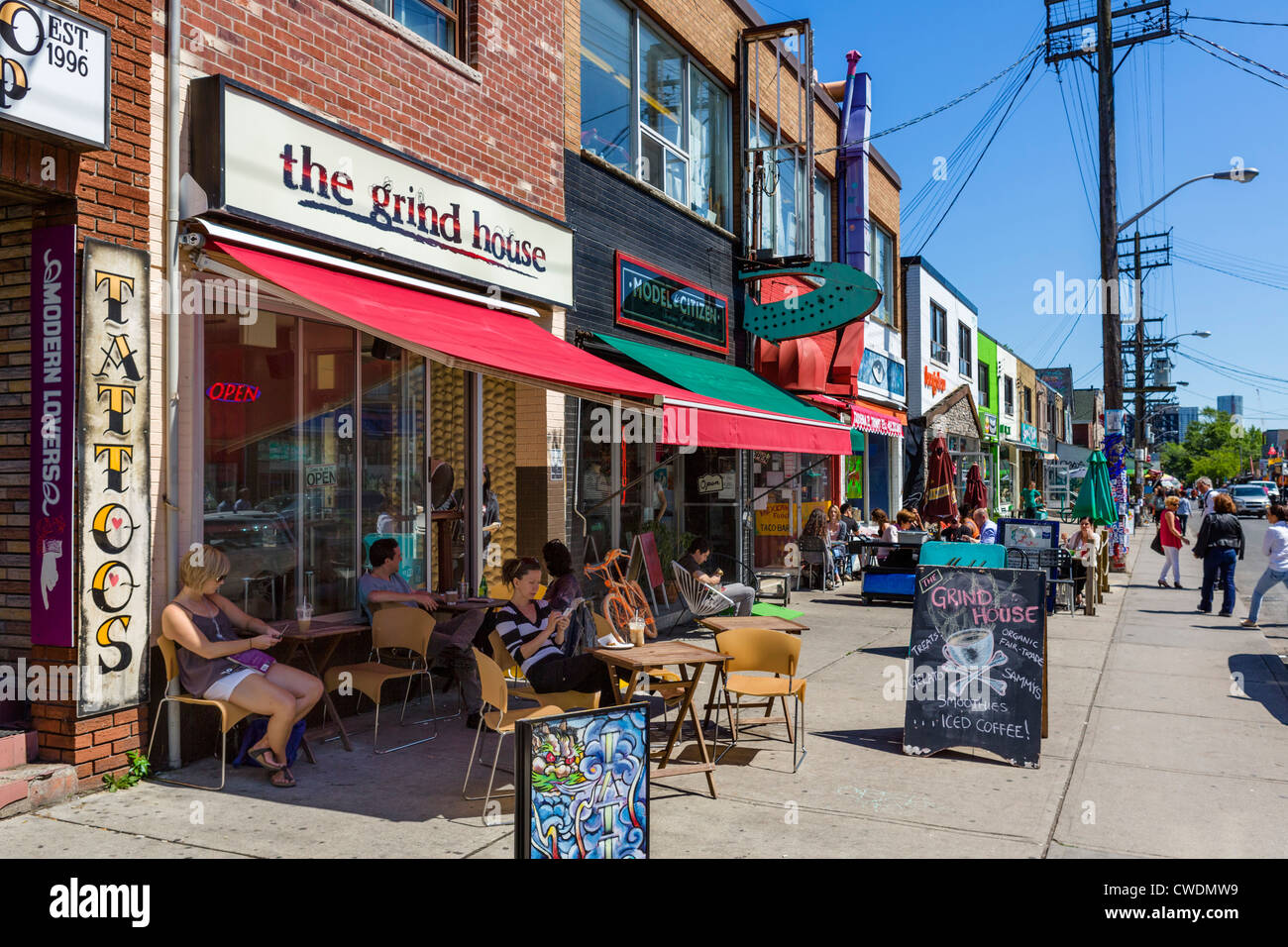 Shops and cafes on Augusta Avenue in the Kensington Market district, Toronto, Ontario, Canada - Stock Image