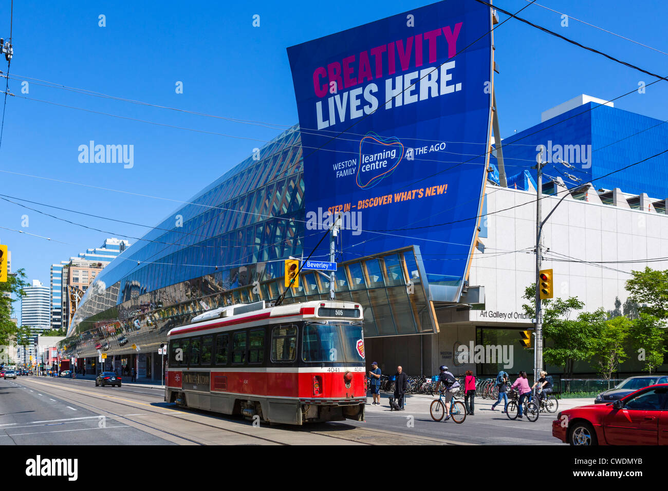 Tram in front of the Art Gallery of Ontario, redesigned by Frang Gehry, Dundas Street West, Toronto, Ontario, Canada - Stock Image