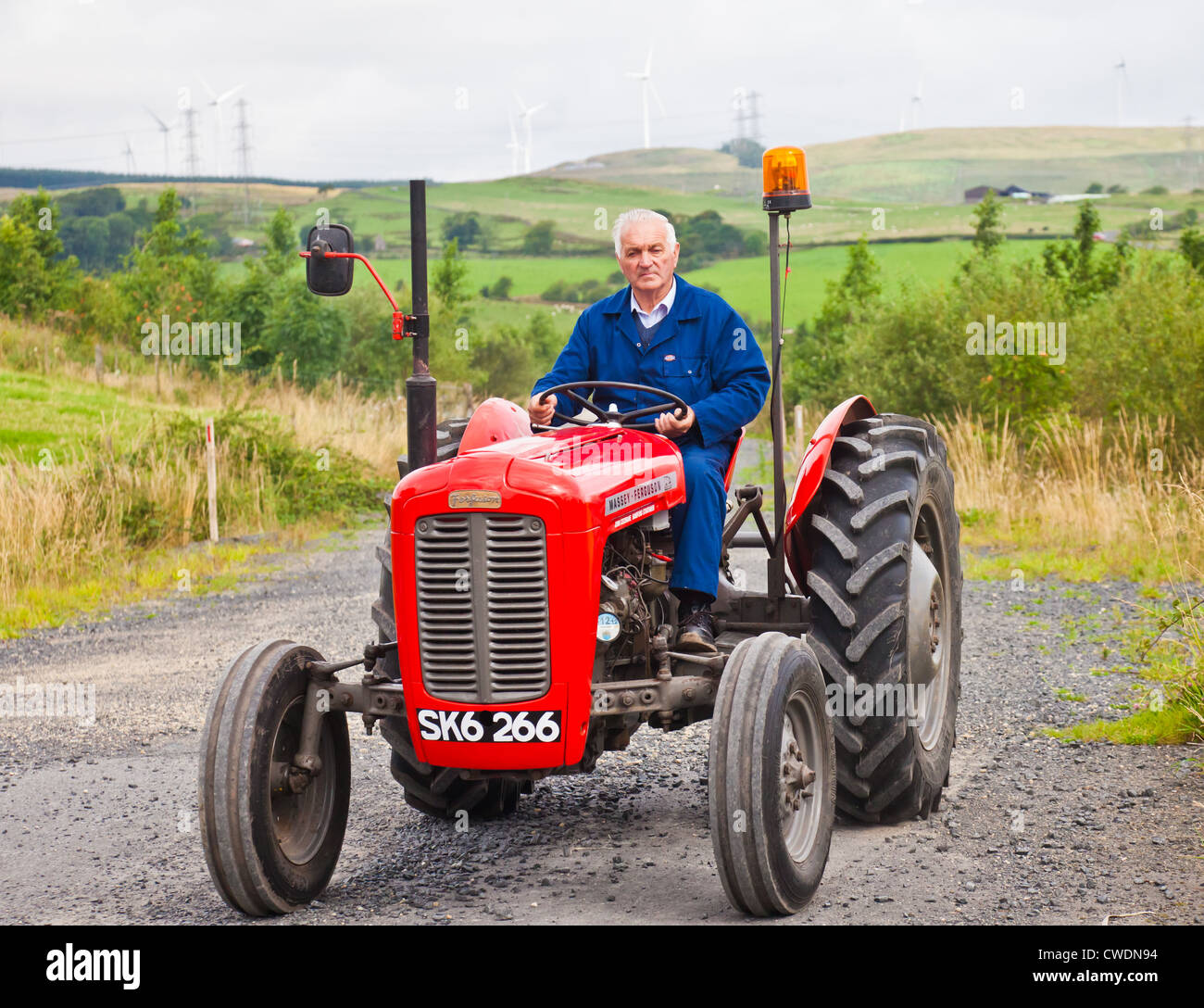 Enthusiast Driving A Red Vintage Massey Ferguson FE35