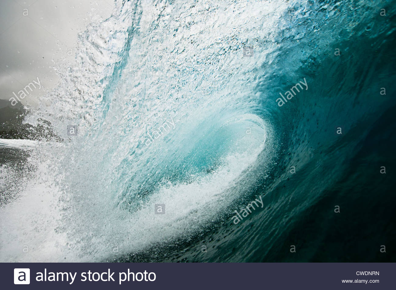 Breaking wave over a coral reef, Rarotonga, Cook Islands. - Stock Image