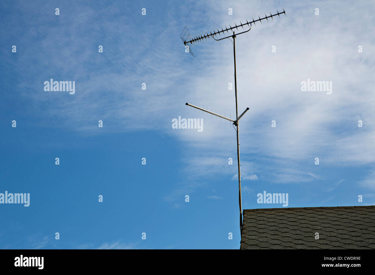 Antenna on the roof transmitting programs on tv - Stock Image