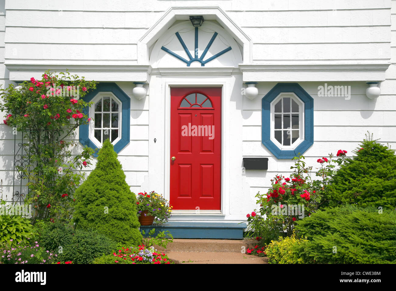A bright red door on the entrance of a home. Stock Photo