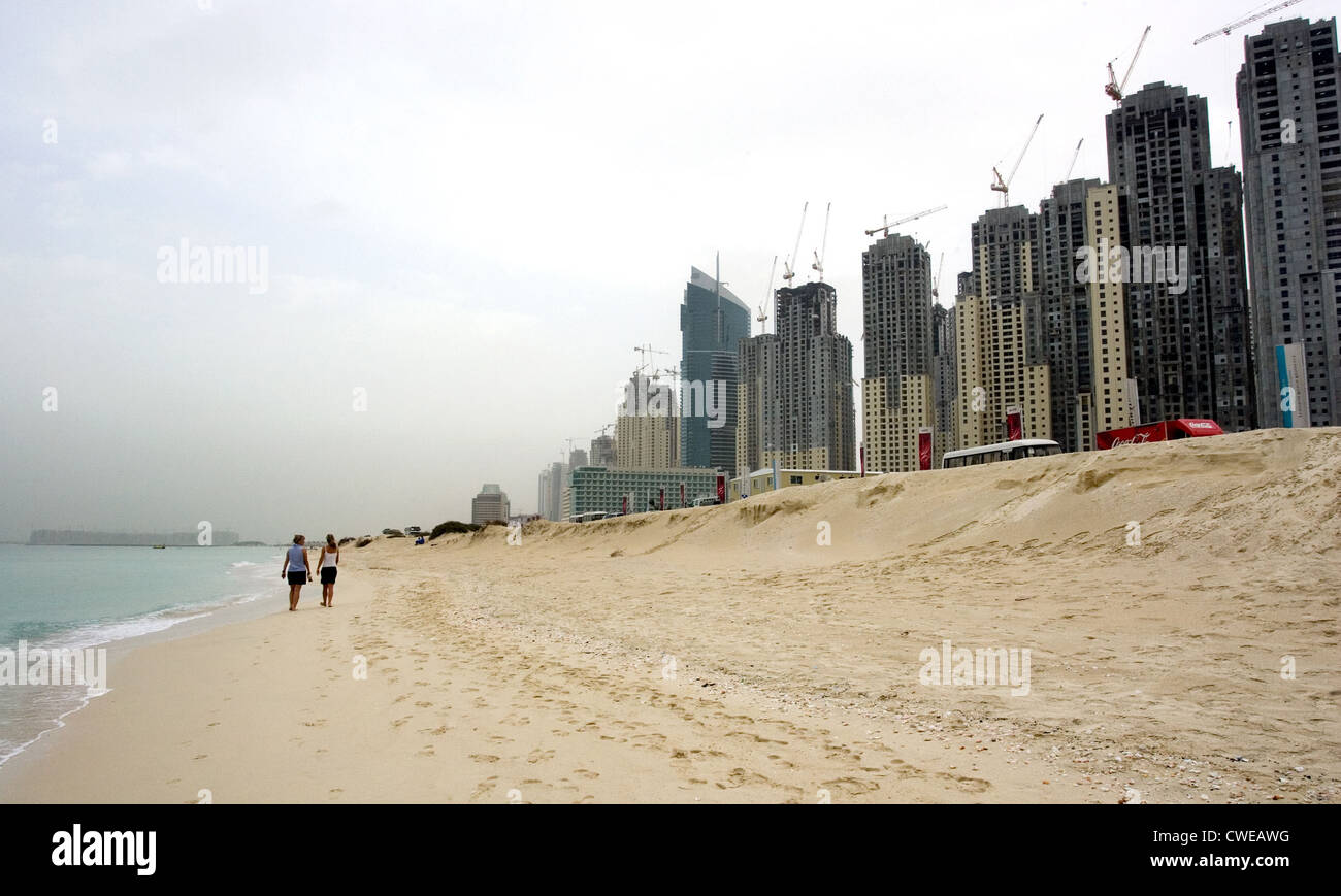 Dubai, the beach in front of the construction site at the Dubai Marina Stock Photo