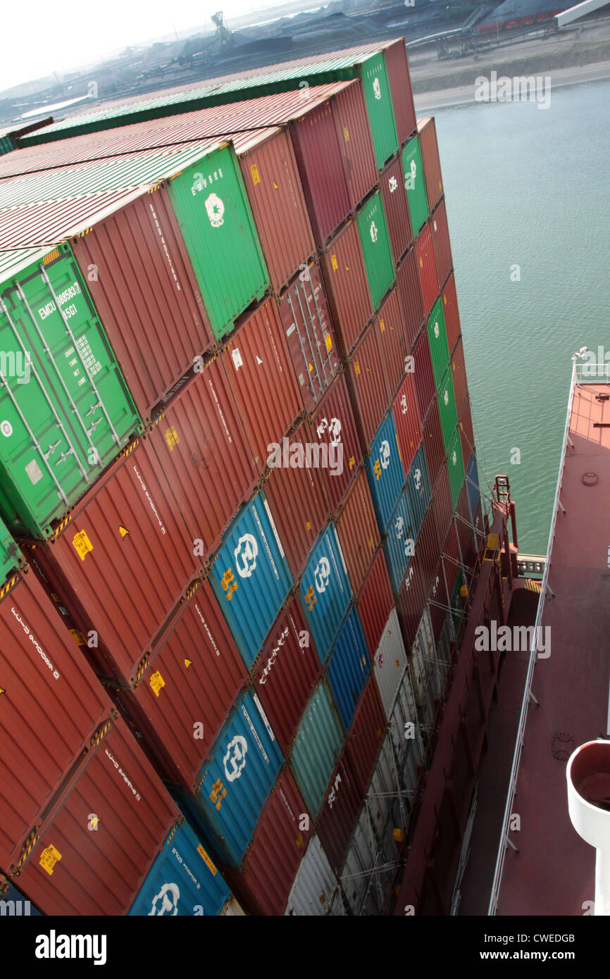 Containers stacked high on deck of a containership, Port of Rotterdam Stock Photo