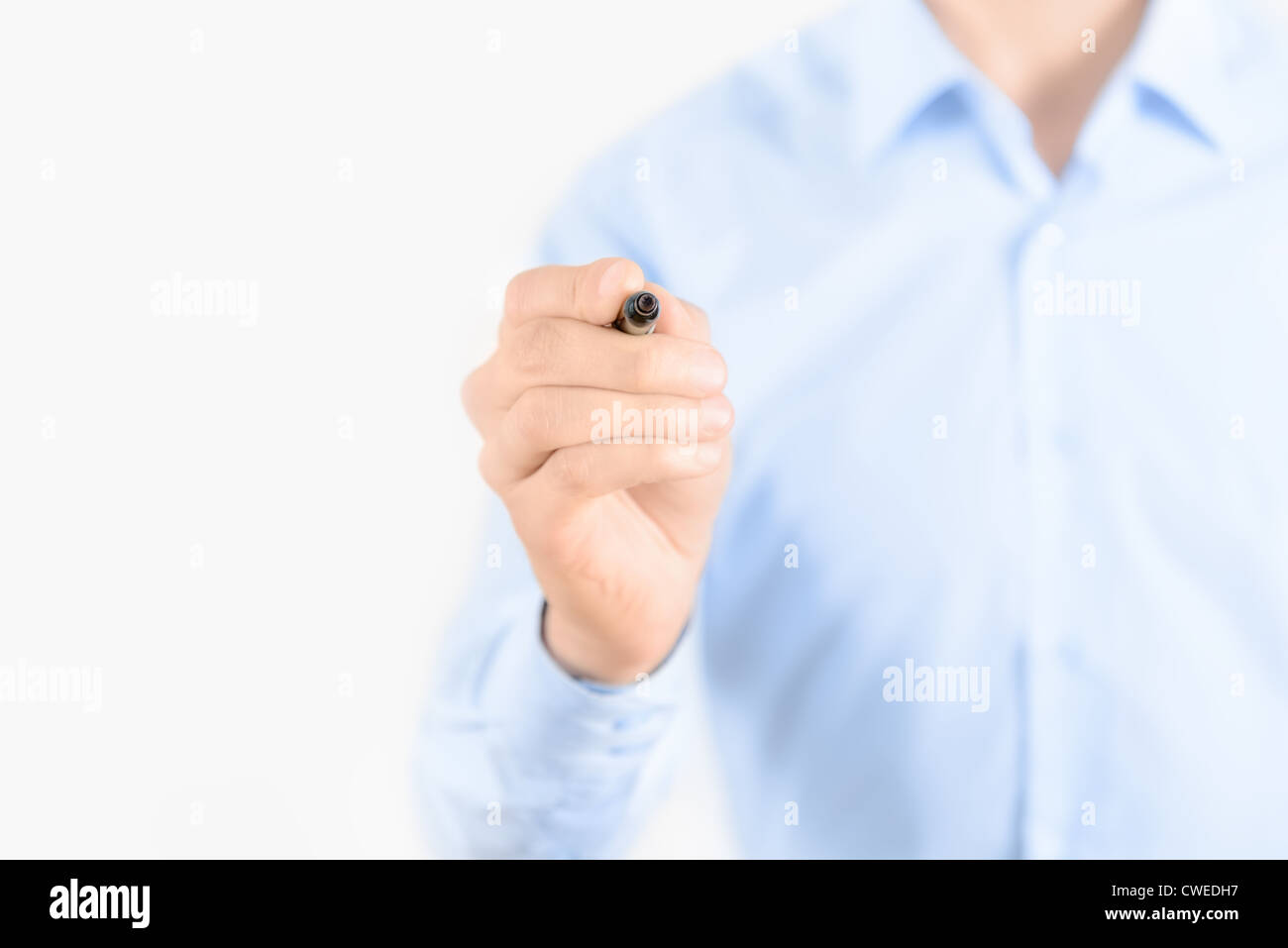Young businessman prepare to start drawing concept. Isolated on white. - Stock Image