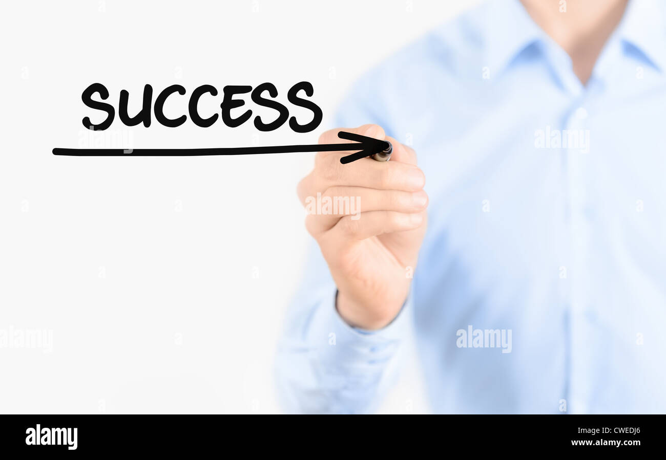 Young businessman drawing success concept. Isolated on white. - Stock Image