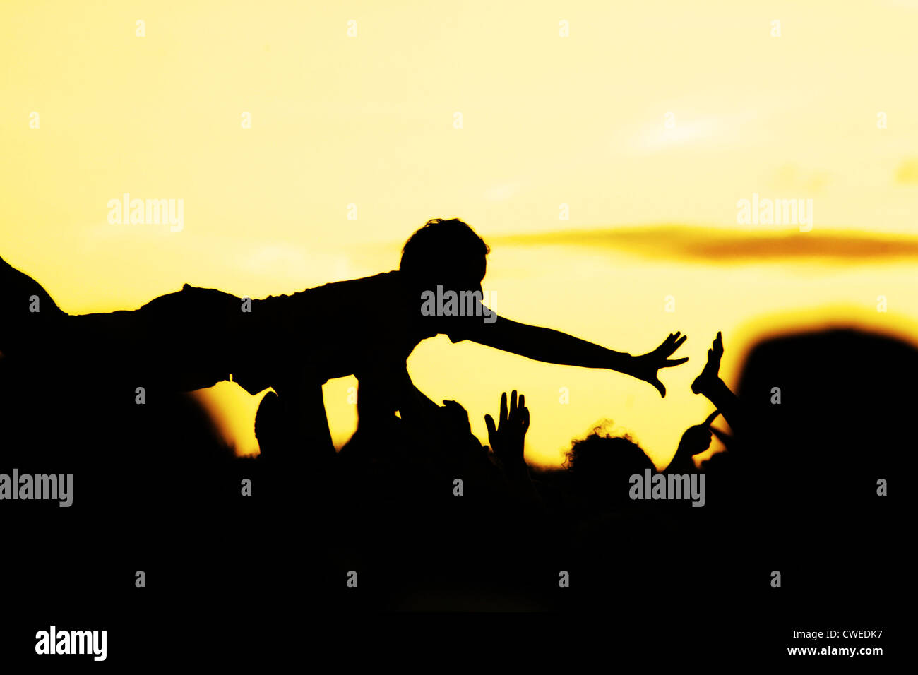 popular music concert,audience,crowd surfing - Stock Image