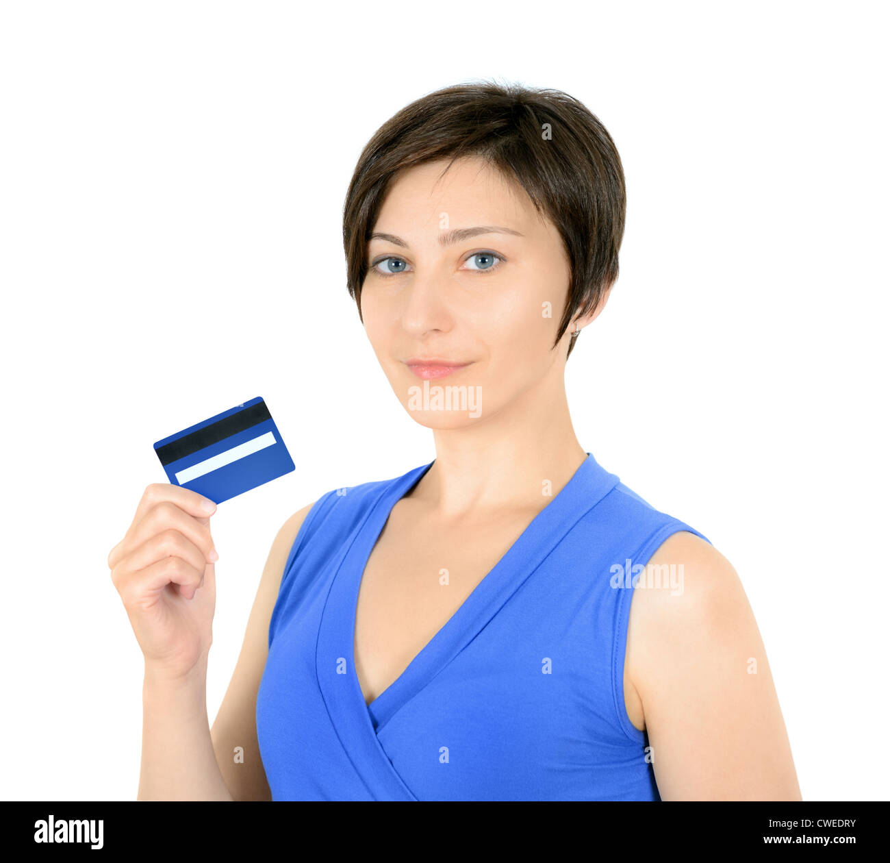 Pretty young woman showing credit card. Isolated on white. - Stock Image