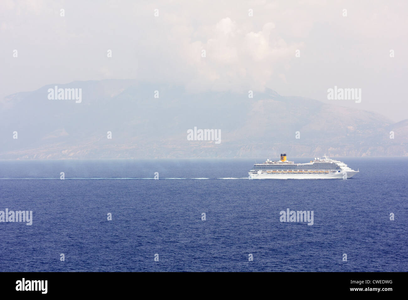 Greece - Sept 7, 2011: The Costa Fortuna cruise ship sailing between the islands of Zakynthos and Kefalonia - Stock Image
