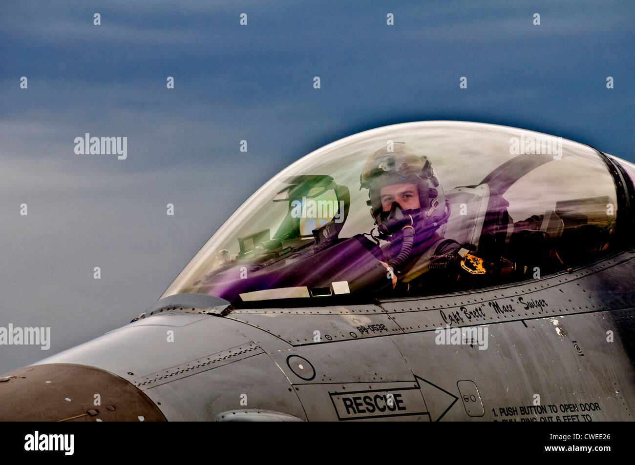 A F-16 Fighting Falcon pilot prepares his jet for de-arming after landing April 17, 2012 at Graf Ignatievo Air Force Stock Photo