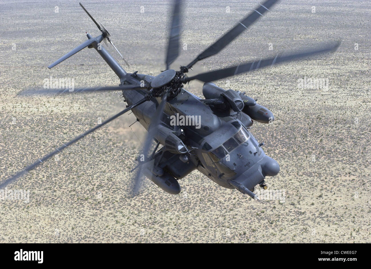 The MH-53J Pave Low III heavy-lift helicopter flies a training mission March 24, 2000 near Kirtland Air Force Base, - Stock Image