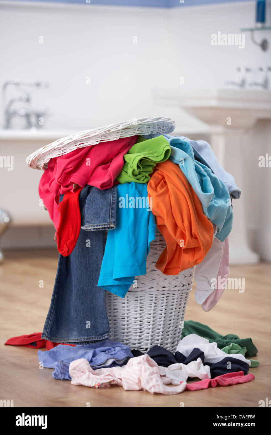 Pile of dirty washing in bathroom - Stock Image