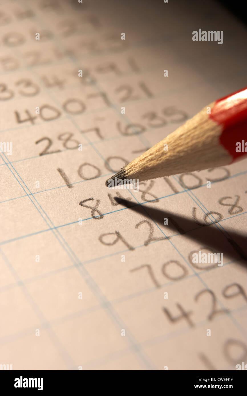 Handwritten numbers in ledger - Stock Image