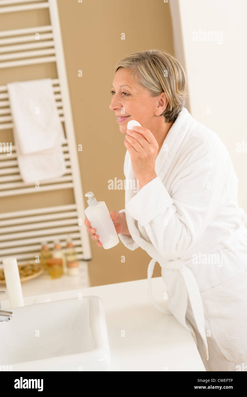 Mature Woman In Bathroom Clean Face Makeup Removal Looking Mirror - How to clean bathroom mirror