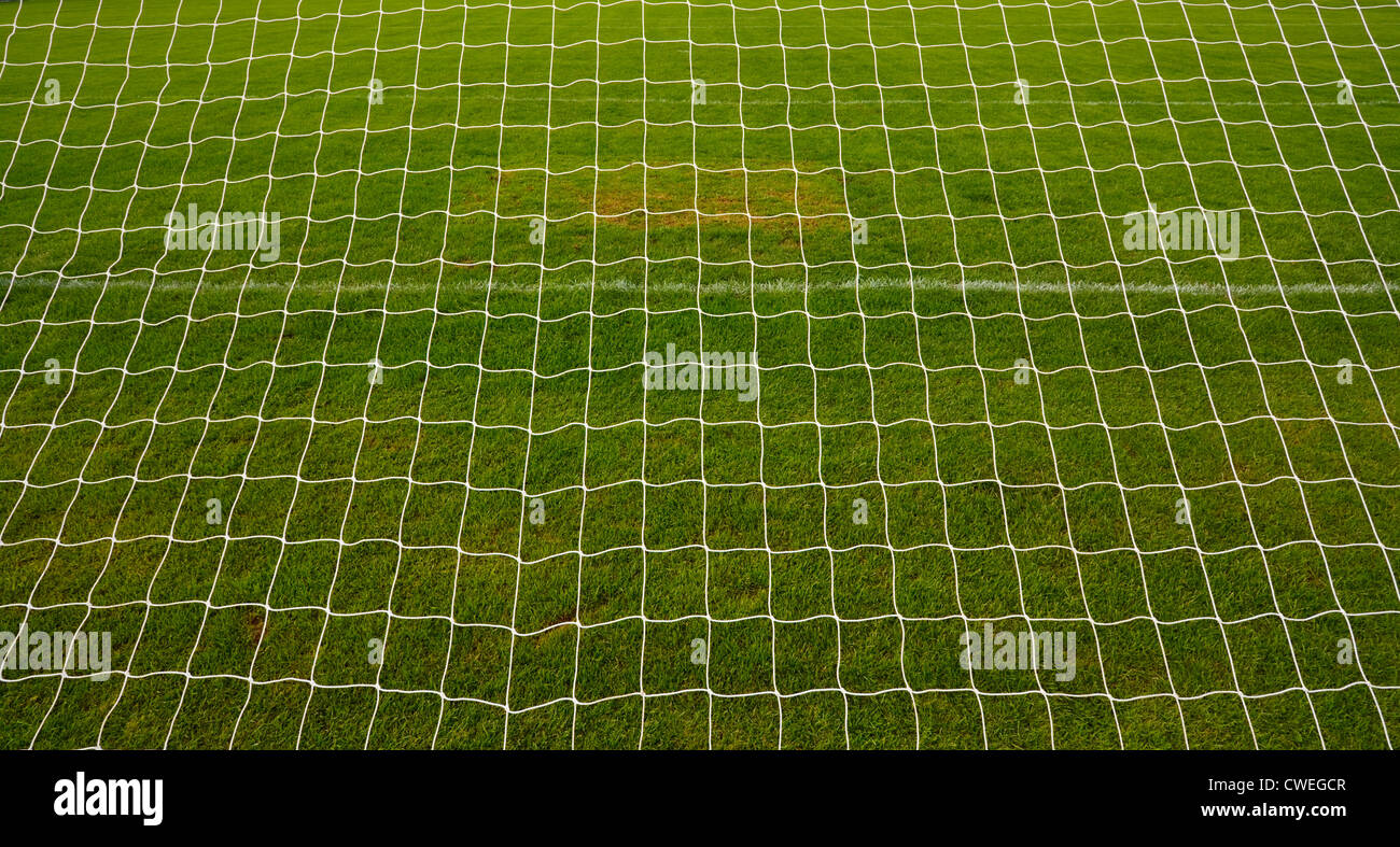 goal net background with grass football pitch or soccer field in america - Stock Image