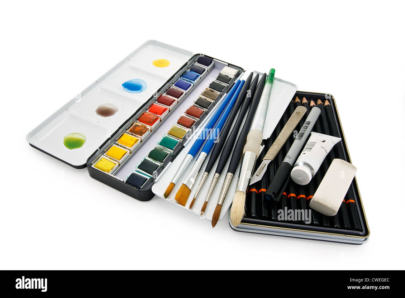 Artists watercolor paint brushes, paints and equipment - Stock Image