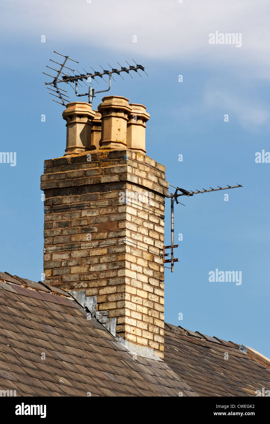 Terrestrial or digital television aerial on house chimney - Stock Image