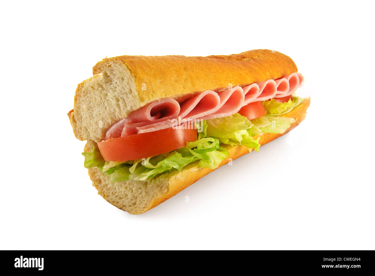 A homemade sandwich with one of the most popular fillings ham salad, made with a freshly baked french bread baguette - Stock Image