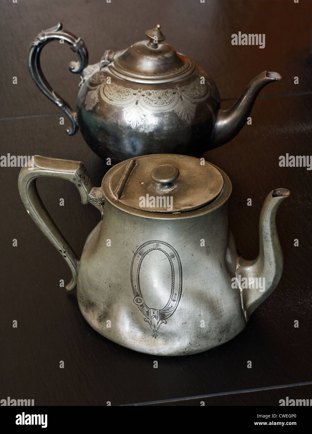 european traditional pewter teapots you might find in an antiques store or auction - Stock Image