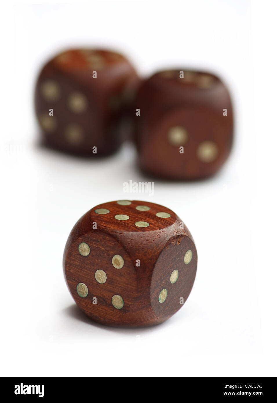 wooden dice on white background - Stock Image