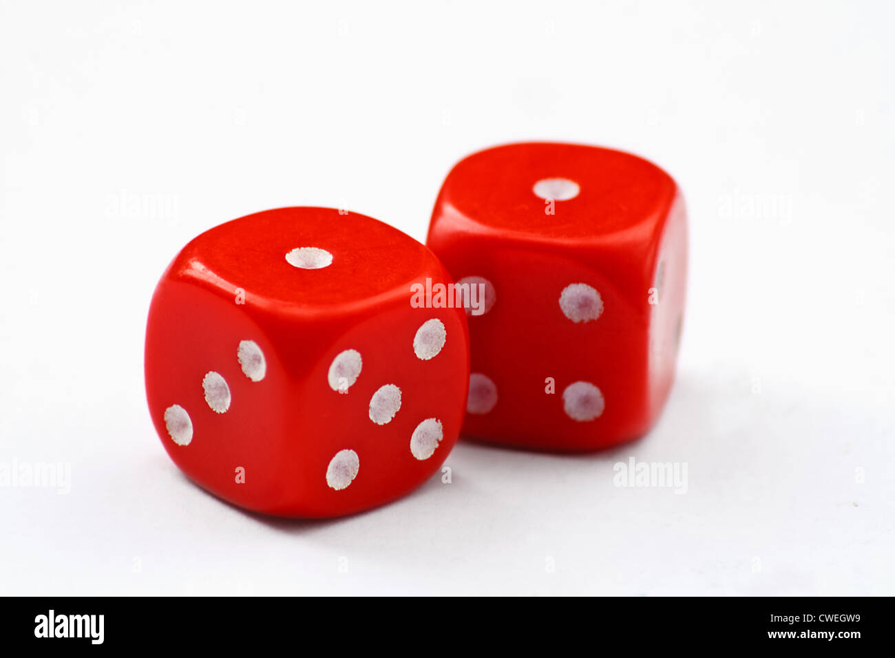Pair of red dice thrown to show snake eyes, isolated on a white background - Stock Image